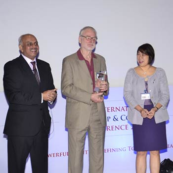 ISEC Master Coach, Krishna Kumar (far left) presenting the IAC Lifetime Achievement Award to Sir John Whitmore (second from left) along with his IAC colleagues from Singapore and Malaysia.